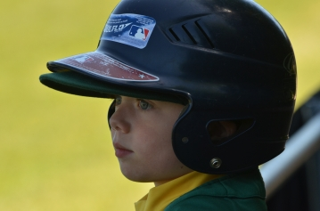 little boy in baseball helmet